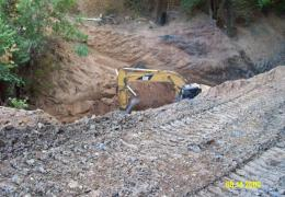 During: An excavator is used to remove the old drainage structures and the aggraded sediment upstream of the crossing