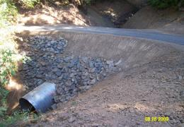 After: The new culvert is set at the natural channel gradient and is sized to accomodate both fish passage and peak flows