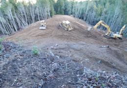 During: Heavy equipment is used to recontour the hillslope and prevent future sediment delivery to Outlet Creek.