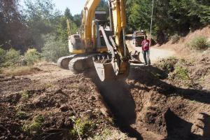 Installing a new stream crossing culvert in the Sheephouse Creek watershed.