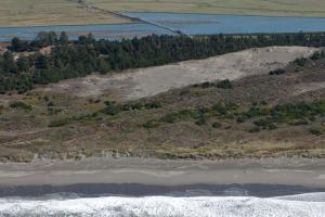 Oblique aerial photo showing the Lanphere Dunes (foreground) and Mad River Slough (background)