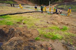 California Conservation Corps crew members implement emergency erosion control measures under PWA technical supervision