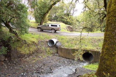 After: An emergency overflow culvert was installed to prevent overtopping when the primary culvert capacity is exceeded
