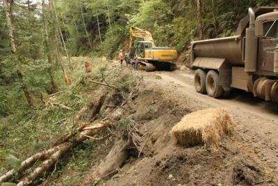 Before: Abandoned road on the steep inner gorge slope of a salmonid stream has been reopened to excavate unstable fillslopes