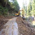 Excavation of sidecast fill and in-place outsloping during road to trail conversion